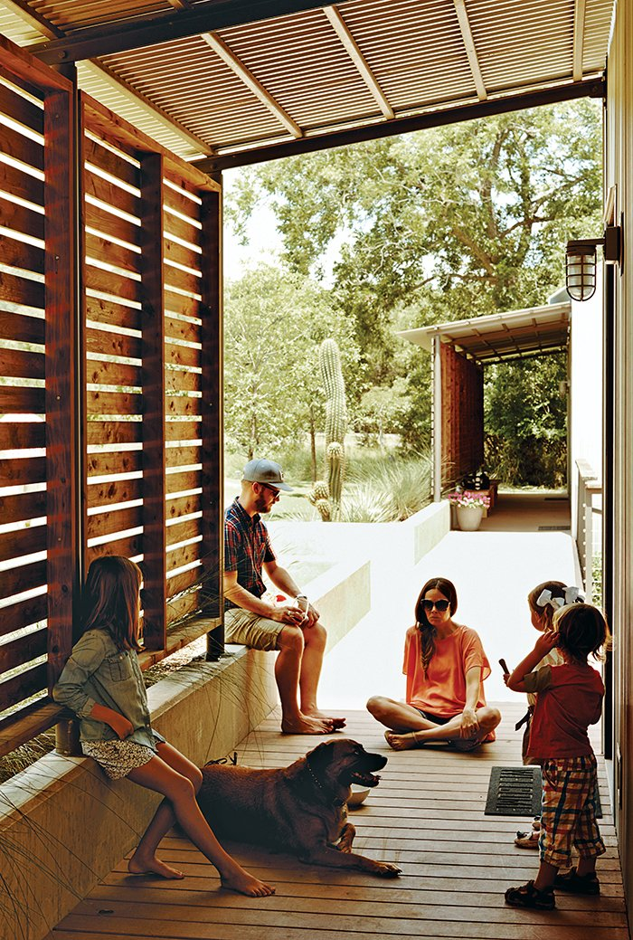 Red-cedar screens shade the modules' western walls, and part of the walkway that connects them, from the Texas sun.