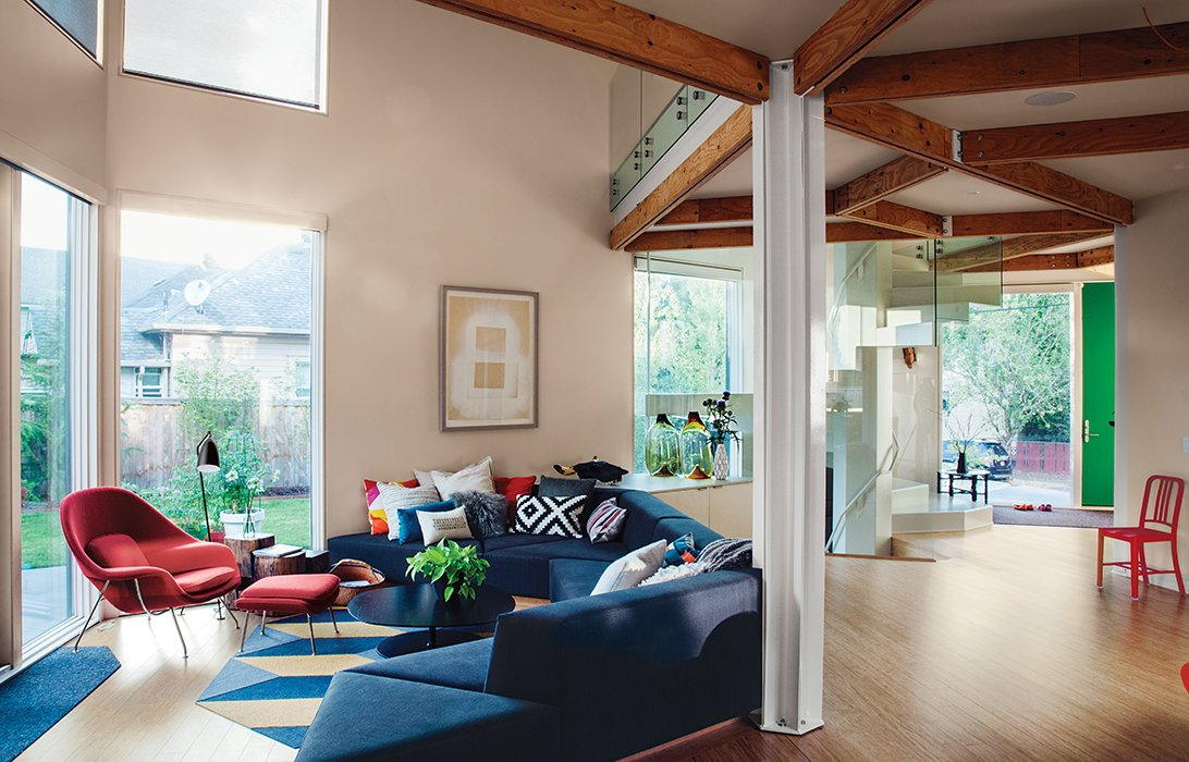 In Portland, Oregon, Jeff Kovel of Skylab Architecture designed a house for Kaja and Kristopher Taft using HOMB triangular modules he developed with Method Homes. HOMB also features a super-insulated building skin and a highly efficient mechanical system. Kovel designed the living room's sofa as well.  Photo 1 of 12 in 28 Triangles Make Up This Hyper-Angular Family Home