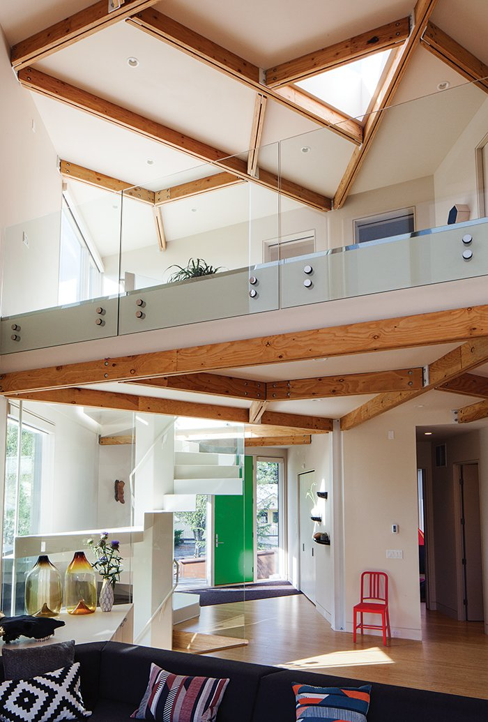 The house's triangle pattern is also visible in the skylight hovering over the double-height main space. The ceiling beams are designed to resemble a honeycomb.. 28 Triangles Make Up This Hyper-Angular Family Home - Photo 3 of 12