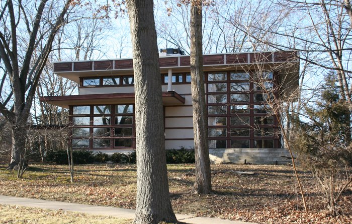 The Rudin House in Madison, built following Lloyd Wright's prefabricated Plan #2 for Marshall Erdman's company, is one of two homes built as a large, flat-roofed square with a double-height living room accented with a wall of windows. [Photo via Mike Condren]  Photo 4 of 6 in A Look at Frank Lloyd Wright's Little-Known Prefabs
