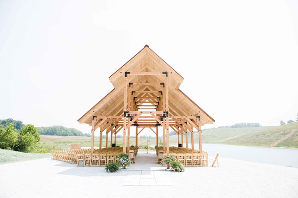 The large open-air pavilion, also overlooking the lake, echoes the retreat's timber construction and natural hues. It hosted the architect's wedding ceremony in the year of its completion, 2014. Photo 8 of Off-Grid Retreat modern home