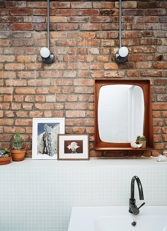 A Godmorgon vanity from Ikea is paired with white field tiles from Mineral Tiles. 10 Charming Brick Interiors - Photo 4 of 11