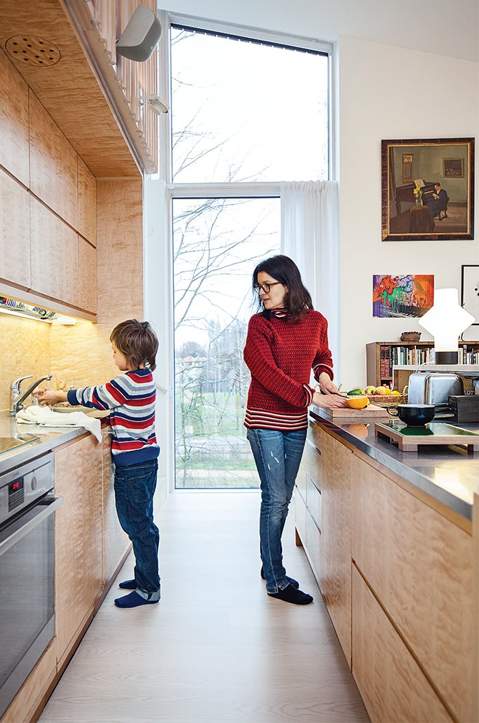 The kitchen is outfitted with a built-in refrigerator by Norcool and an AEG cooktop and oven.