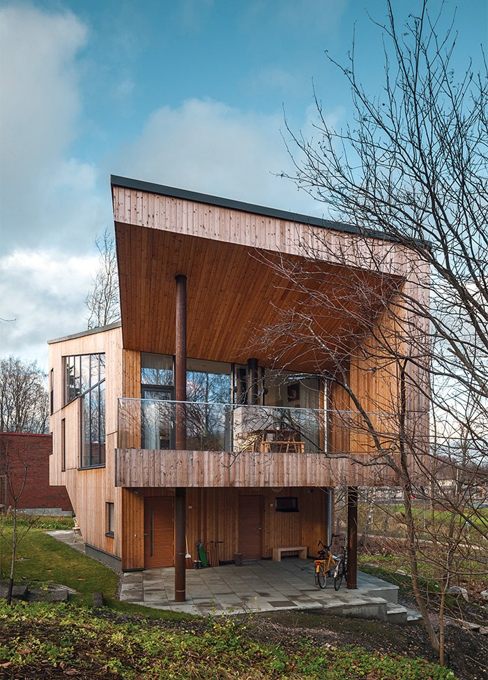 The exterior is clad in Siberian larch, which doesn't require paint and will develop a gray patina.  Photo 11 of 12 in This Cozy Finnish Home Would Not Be Complete Without a Sauna