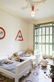 Historic Details and Playful Modernism Meet in this Stunning Barcelona Flat - Photo 6 of 8 -