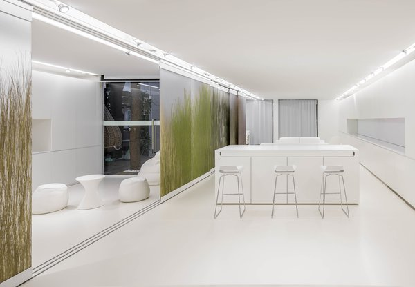 """NArchitekTURA chose a monochromatic white interior for its """"Apartment of the Future—R&D Laboratory"""" in Dobrodzień, Poland, taking a cue from the design of contemporary cellphones and other mobile devices."""