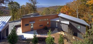 A Contemporary North Carolina Home Navigates a Tricky Site Atop a Ridge - Photo 1 of 10 -