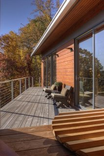 A Contemporary North Carolina Home Navigates a Tricky Site Atop a Ridge - Photo 10 of 10 -