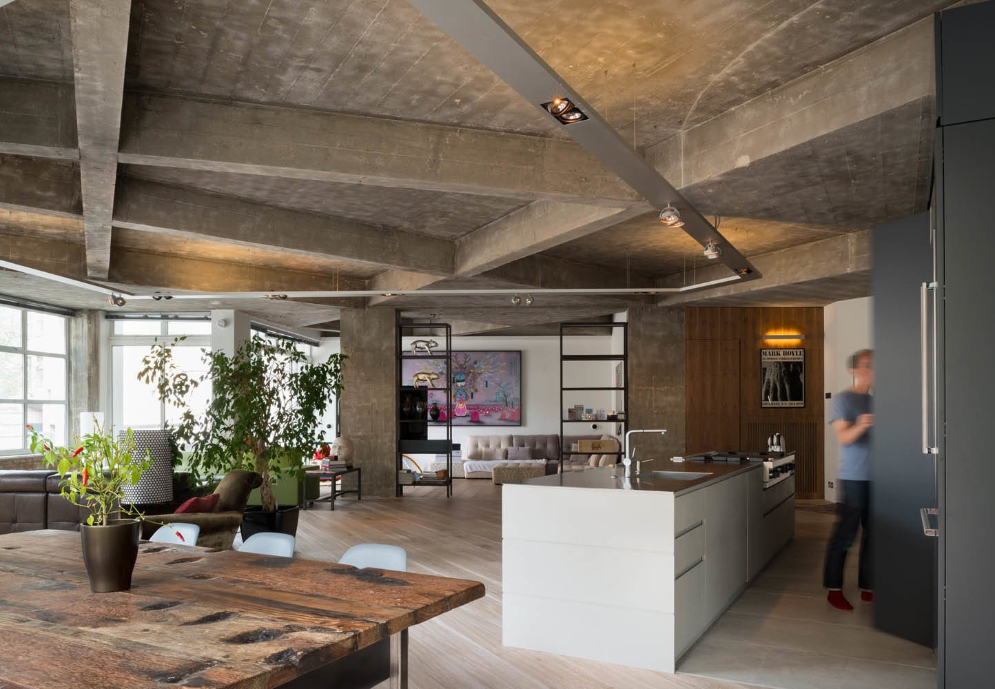 Inside Out Architecture renovated an apartment in the Clerkenwell section of central London, removing interior walls to create an open, loft-like living space. Photo by Jim Stephenson. Tagged: Kitchen and White Cabinet.  Photo 1 of 8 in Renovation Opens Up a London Apartment