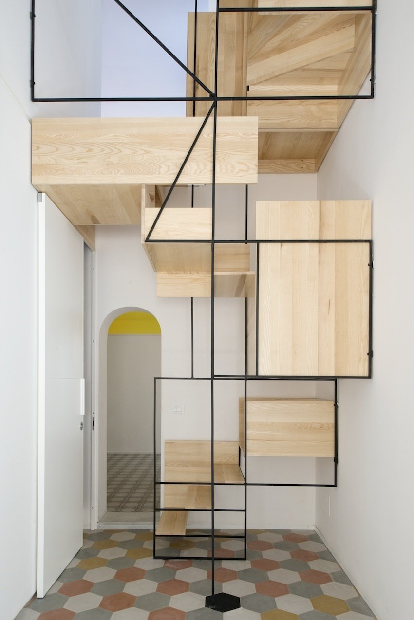 The oak-and-steel structure, as much a sculpture as a set of stairs, animates the interior of this slender, multi-story building.  190+ Best Modern Staircase Ideas by Dwell from A Mind-Blowing, Mondrian-Esque Staircase