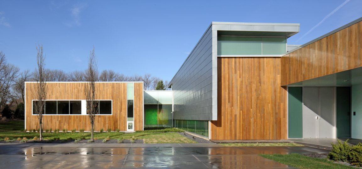 """""""The most challenging aspect of the project was the client's directive to 'design an art gallery we can live in,'"""" says architect Jeff Dolezal of local firm Tack Architects. Though the house is quite large—over 10,000 square feet—it was constructed with green design principals in mind. It features low-VOC paints and interior finishes, locally sourced materials, blown in soy-based spray foam exterior insulation, skylights and solatubes for natural daylighting, and FSC certified lumber, and LED light fixtures. The exterior is clad in zinc and cedar.  Omaha Art-Inspired House by Diana Budds from Modern Dwellings in the Midwest"""