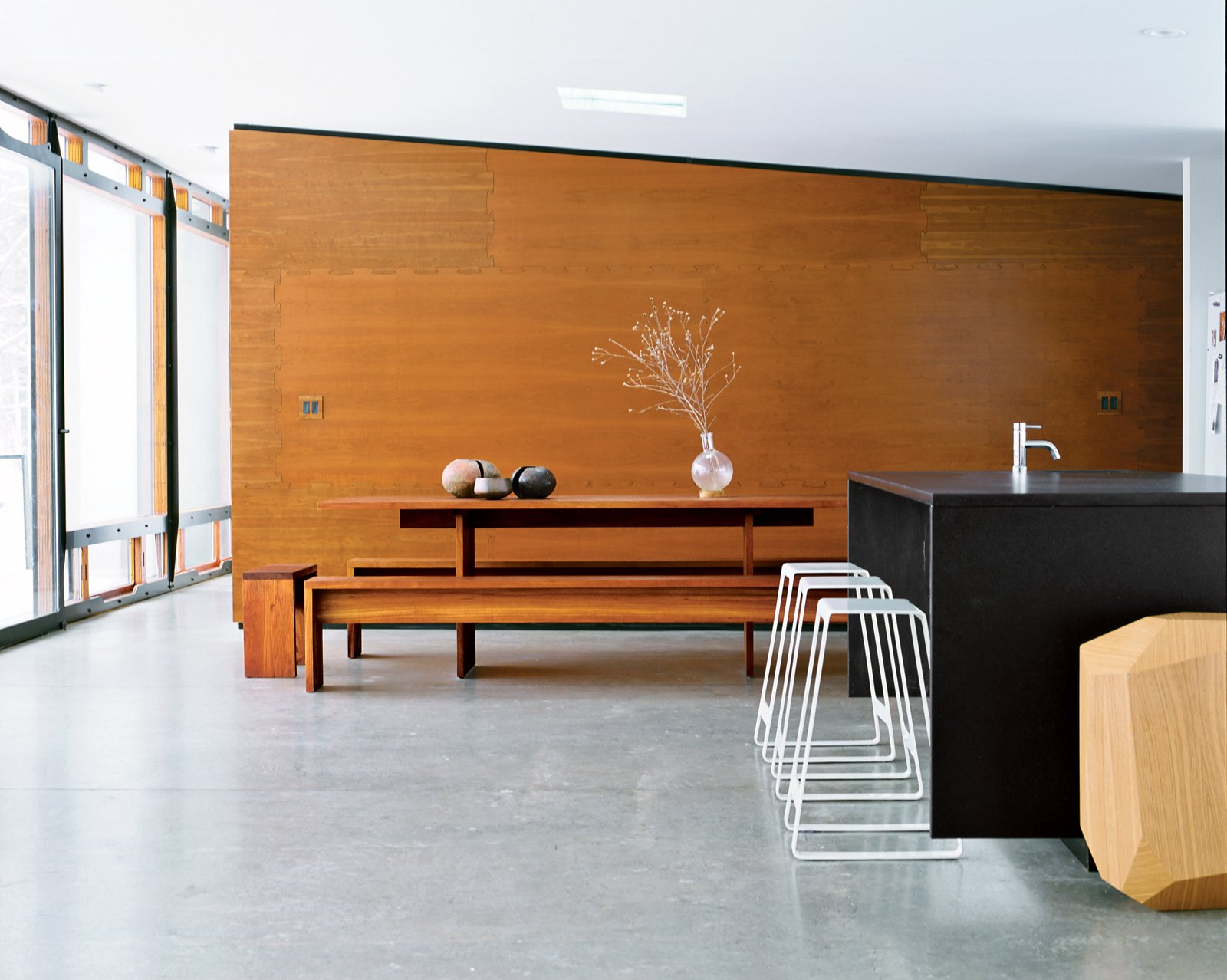 The table in the dining area was found in Venice, California, and the geometric table is a prototype by Arik Levy. Tagged: Dining Room, Bench, and Table.  Photo 5 of 12 in A Hybrid Prefab Home in Upstate New York from Interior Designers Speak: 18 Common Design Mistakes to Avoid