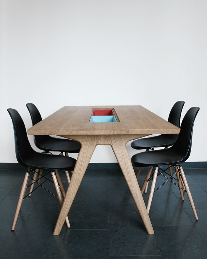 """Paired with Eames side chairs, her dining table includes two cases """"to either hide or show things,"""" she says."""