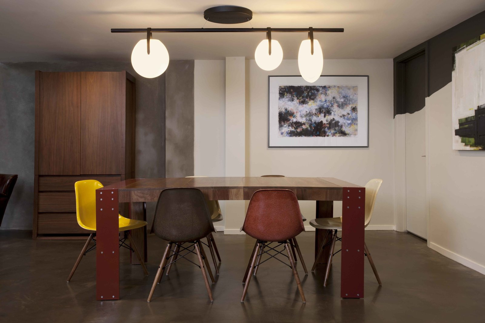 The dining room features vintage Eames shell chairs with new walnut legs, an Ovaata Dining Table by Element Living, and a Gala 7220 chandelier by Rich Brilliant Willing.  Modern Dining Rooms by Allie Weiss from San Francisco Loft in a Former Movie Palace