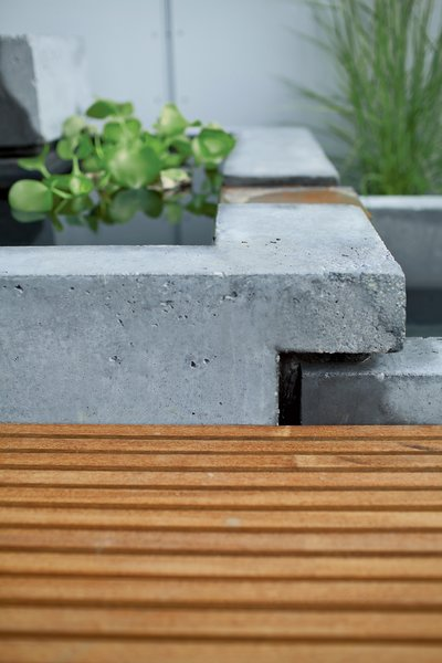 A detail of the interlocking concrete tubs.