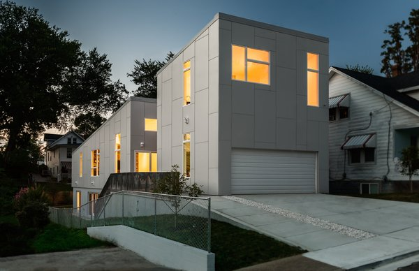 The house, shown here from the street, was designed for two full-time residents and to accommodate visiting children and grandchildren. Its name—the 10 Degree House—comes from the roof's angle.