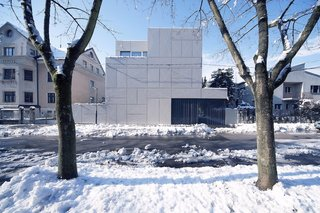10 Homes With Distinctive Facades - Photo 10 of 10 - Architect Rok Oman of OFIS Architects started the renovation of what would become Villa Criss-Cross by tackling a thorny site issue. Since it is located close to the street and perpendicular to the old Roman wall near Ljubljana's ancient fortress, zoning laws require buildings to be set four meters back from the street. By maintaining the original wall and adding steel panels, Oman grandfathered in the new structure and maintained the original orientation.