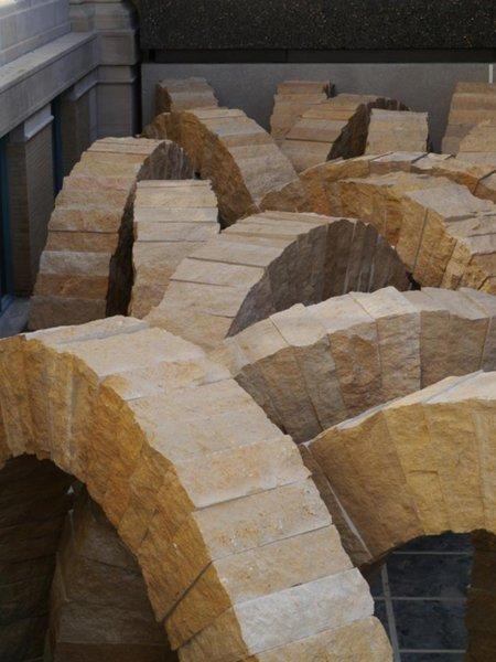 Complementing a British architect is British sculptor Andy Goldsworthy. A site-specific installation, Stone Sea consists of 25 10-foot arches comprised of stone from the Earthworks Quarry in nearby Perryville, Missouri. Coming in at a whopping 13 tons each, the arrangement of the arches mimics waves of the seas that once covered St. Louis and will occupy space bridging the Main Building with the East. Installation in progress. Image courtesy of the Saint Louis Art Museum.