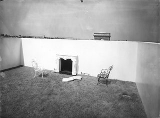 A Corbusier-Inspired Parisian Home - Photo 9 of 11 - Le Corbusier's outdoor garden with a fireplace and the grass lawn 'carpeting.'