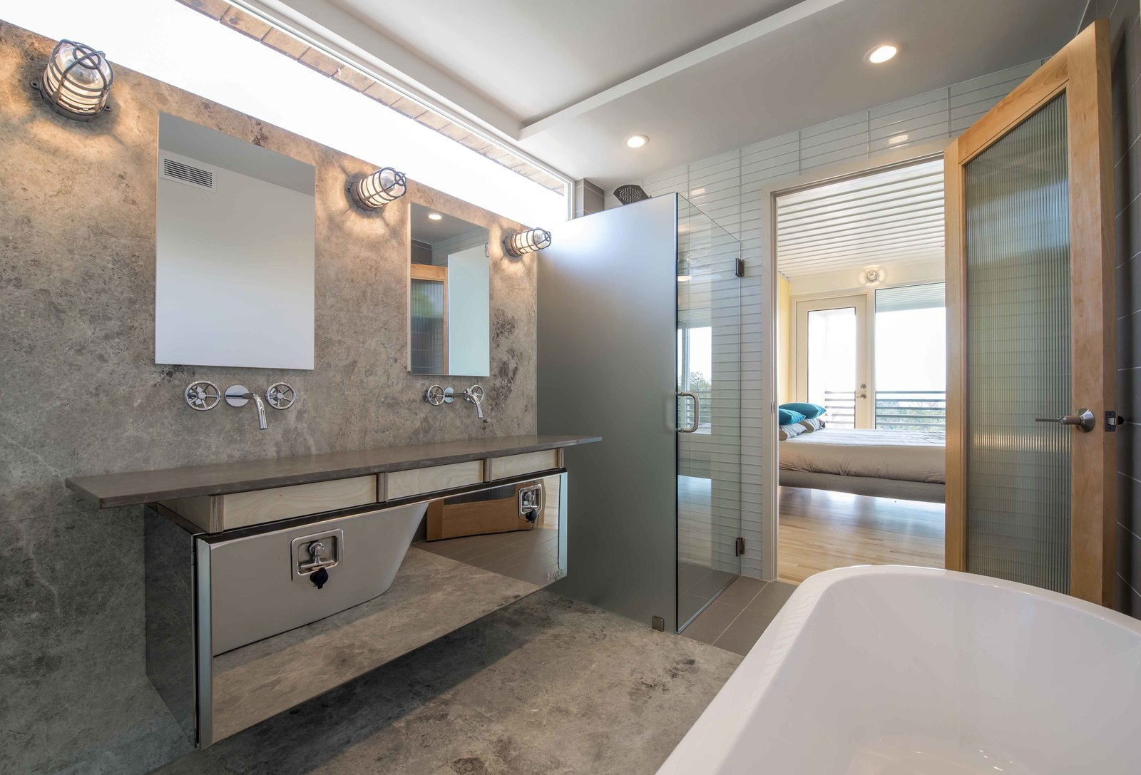 The industrial thread continues as a truck tool box converts into an elegant vanity in the master bathroom.  This House Was Built Out of 14 Shipping Containers by Esha Chhabra