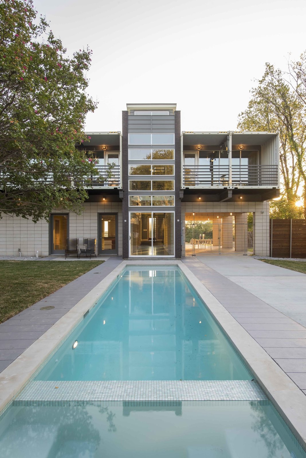 A 40 foot by 10 foot pool is designed to echo the house's tower with an almost reflection-like alignment.  This House Was Built Out of 14 Shipping Containers by Esha Chhabra