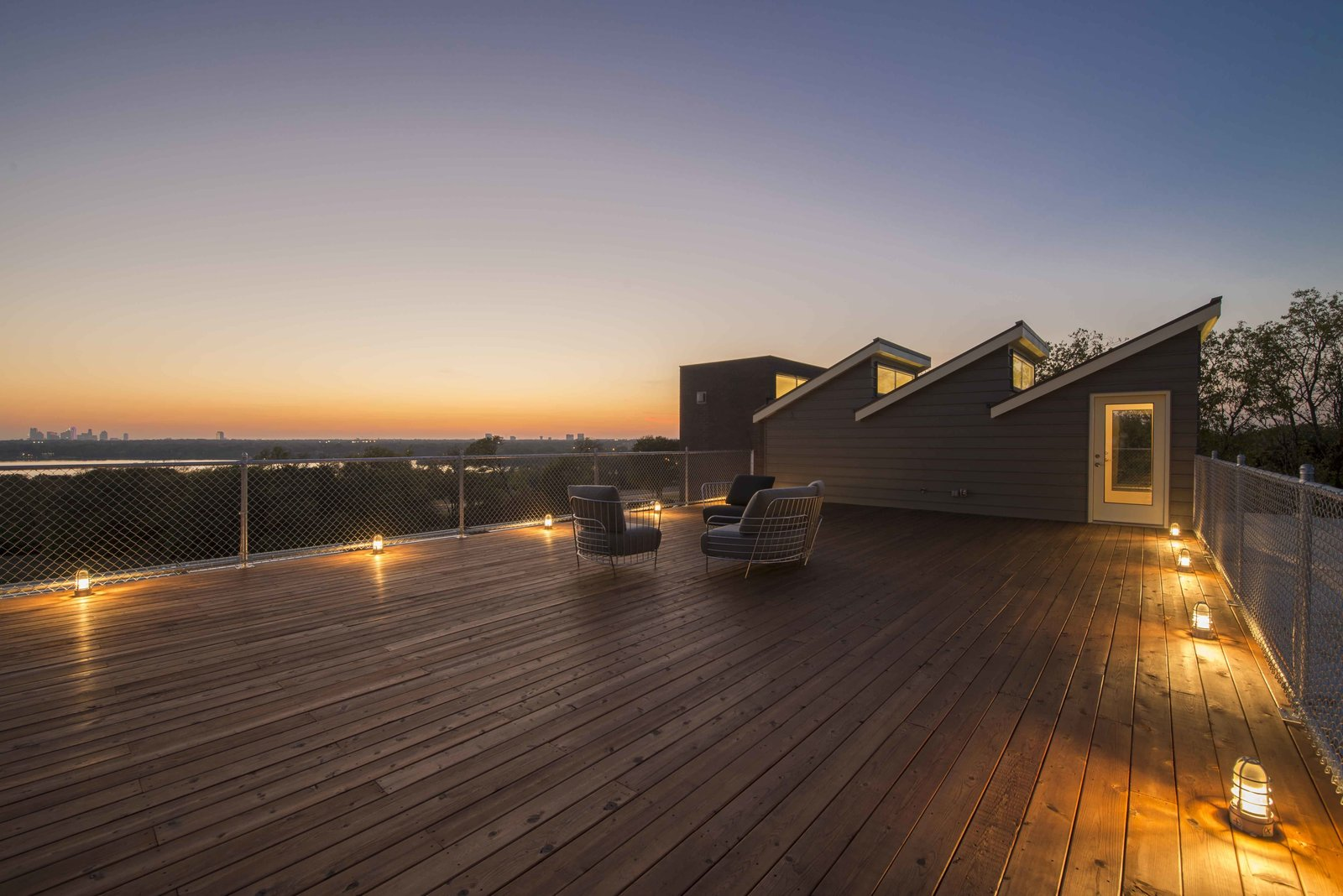 A 1400-square-foot roof deck offers panoramic views, overlooking White Rock Lake with one of the highest elevations in the city.  This House Was Built Out of 14 Shipping Containers by Esha Chhabra