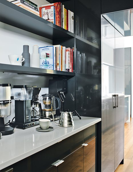 The firm also designed the kitchen, which was fabricated by Thomson Cabinetry.  Photo 7 of 13 in Minimal North Carolina Home Built for a Tech-Forward West Coast Couple