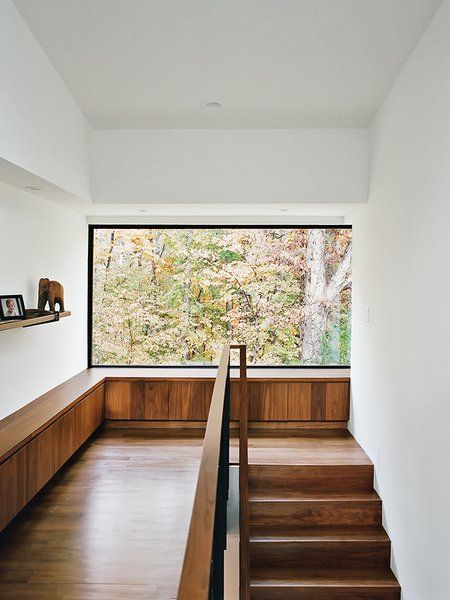 Amy requested a quiet, sunny reading nook with a view; In Situ obliged with a built-in bench housing her collection of books. Tagged: Staircase, Wood Railing, and Wood Tread.  Photo 8 of 13 in Minimal North Carolina Home Built for a Tech-Forward West Coast Couple