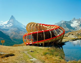 101 Best Modern Cabins - Photo 53 of 101 - Livable sculpture at its finest. Created for the Zermatt Festival, an annual festival of chamber music, this structure (designed by a team of second-year architecture students!) maximizes the beauty of its surroundings with its 720-degree spiral composition. Valais, Switzerland. By Alice Studio/Atelier de la Conception de l' Espace from the book Rock the Shack, Copyright Gestalten 2013.