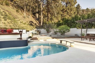 8 of the Best Modern Pools to Dream of Before the End of Summer - Photo 6 of 8 - Mass Studio completed the renovation of a 1960s house in Brentwood, California, that came complete with a classic midcentury kidney pool. During the renovation, the patio and area around the pool was refreshed with a lounge area, fire pit, and plants.