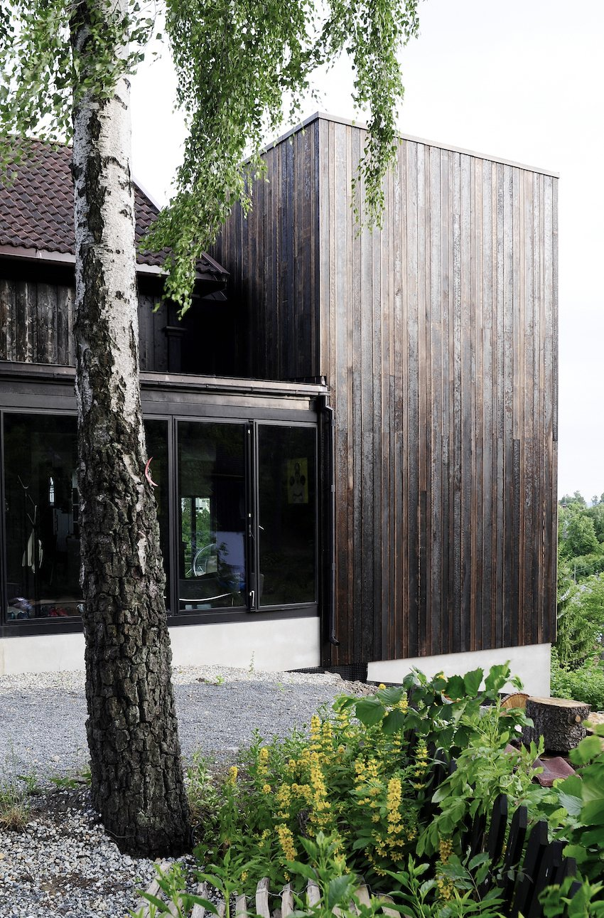 """A simple black box in many ways, the Ankersvingen Annex succeeds with its simplicity; it adds space without subtracting from the surroundings. """"It was a really neat connection between the house and garden, which was totally lacking with the existing architecture,"""" says architect Thor Olav Solbjør of SAAHA. """"We took the stunning views of the fjord as the starting point."""""""