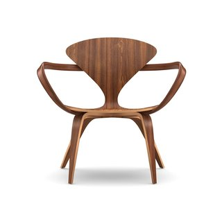 A Cherner Chair Retrospective - Photo 23 of 23 - Connecticut. Benjamin Cherner reproduces the iconic designs of his father, Norman, for the Cherner Chair Company, based in Ridgefield, Connecticut. The furniture, like this lounge arm chair, sports organic shapes made in molded plywood with a natural walnut finish.
