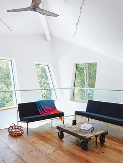 A Mind-Bending Renovation Brings a Bold, Modern Addition to an Old Farmhouse - Photo 11 of 22 - A sitting area outside the master bedroom overlooks the dining room.
