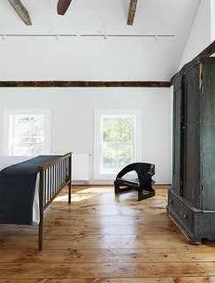 A Mind-Bending Renovation Brings a Bold, Modern Addition to an Old Farmhouse - Photo 12 of 22 - Kartell's 4801 chair occupies a corner of the master bedroom.