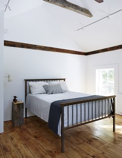 A Mind-Bending Renovation Brings a Bold, Modern Addition to an Old Farmhouse - Photo 13 of 22 - All of the home's wide-plank floors were reclaimed from the original farmhouse during the demolition process.