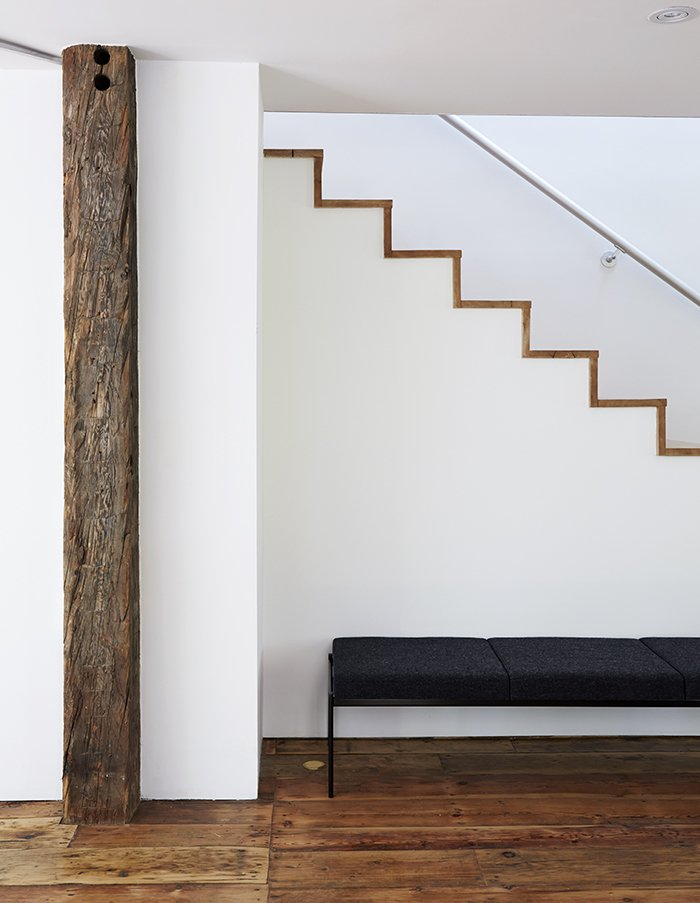 The modern staircase was built with the same salvaged wall planks that are used as flooring throughout.
