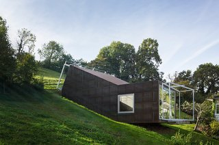 """Architect Christian Tonko played with a double metaphor when designing the Camera Lucida studio. The name of the cantileverd hillside space, Latin for """"bright chamber,"""" references the open window facing the valley below, as well as the skylight that bathes the workspace in natural light."""
