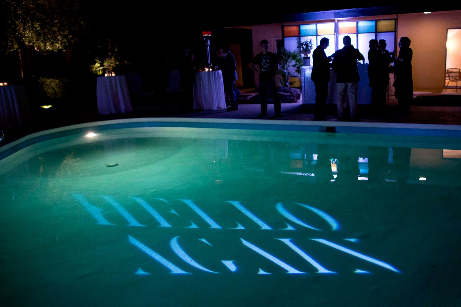 """Guests mingled around the pool. Hello Again welcomed partygoers to rethink the typical dinner party.  Search """"events-this-weekend-318-21.html"""" from Dinner with Dwell & Lincoln"""