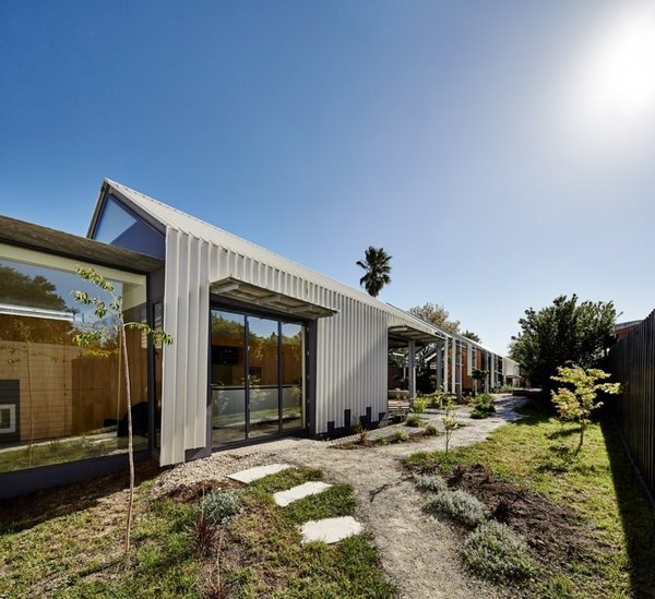 In their renovation, Austin Maynard Architects decided to leave the structure deliberately incomplete. The existing bungalow transitions into an empty frame that houses an open-air corridor. Photo  of Cut Cut Paw Paw modern home