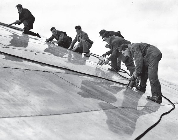 At the time of completion (workmen rivet panels onto the roof), the 365-foot span (also the height of St. Paul's Cathedral) made it the largest dome on the planet. Photo courtesy CHELSEA Space.