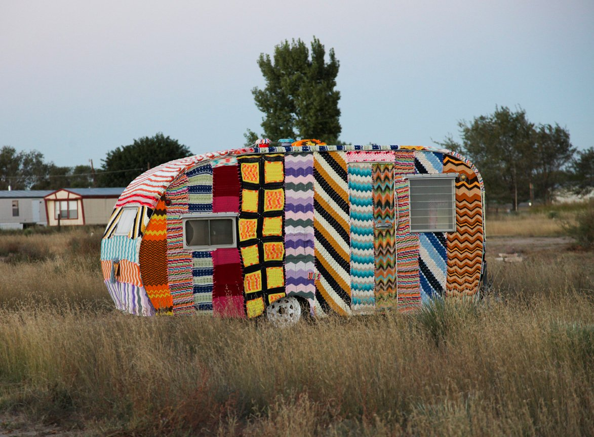 A neon textile-covered trailer sits in Marfa, Texas' El Cosmico. Via simply photo.
