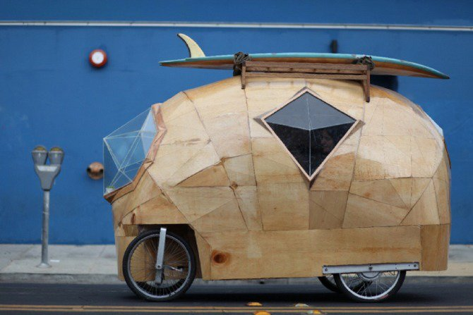 Designed by SF-based artist Jay Nelson, the Golden Gate is a modern electric camper car made with fiberglass, epoxy resin, plywood, glass, bike parts, and an electric motor. Comes with a kitchen, stove, cooler, storage cubbies, toilet, bed, and storage below the bed. And get this—the driver sits cross-legged while operating the vehicle.  Cool Airstreams by Eujin Rhee