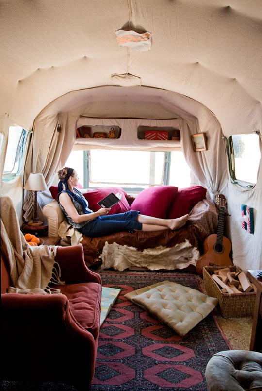 About a mile from the Pacific Ocean on a tropical fruit farm lies Julie Montgomery's (seen here) renovated Airstream home which she shares with her son, Henry. Via Apartment Therapy.