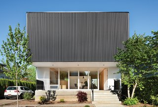 15 Modern Homes with Black Exteriors - Photo 6 of 15 - Architect Ben Waechter wrapped the upper floor of Nick Oakley's house in inexpensive black corrugated steel. By rounding the corners, Waechter avoided unsightly trim at the edges.