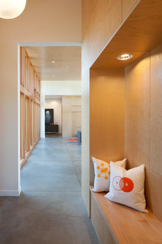 Built-in storage in the hallway also makes use of the birch paneling seen overhead. A built-in bench and LED lighting make for a nice nook.  Photo 5 of 11 in Modern in the Country