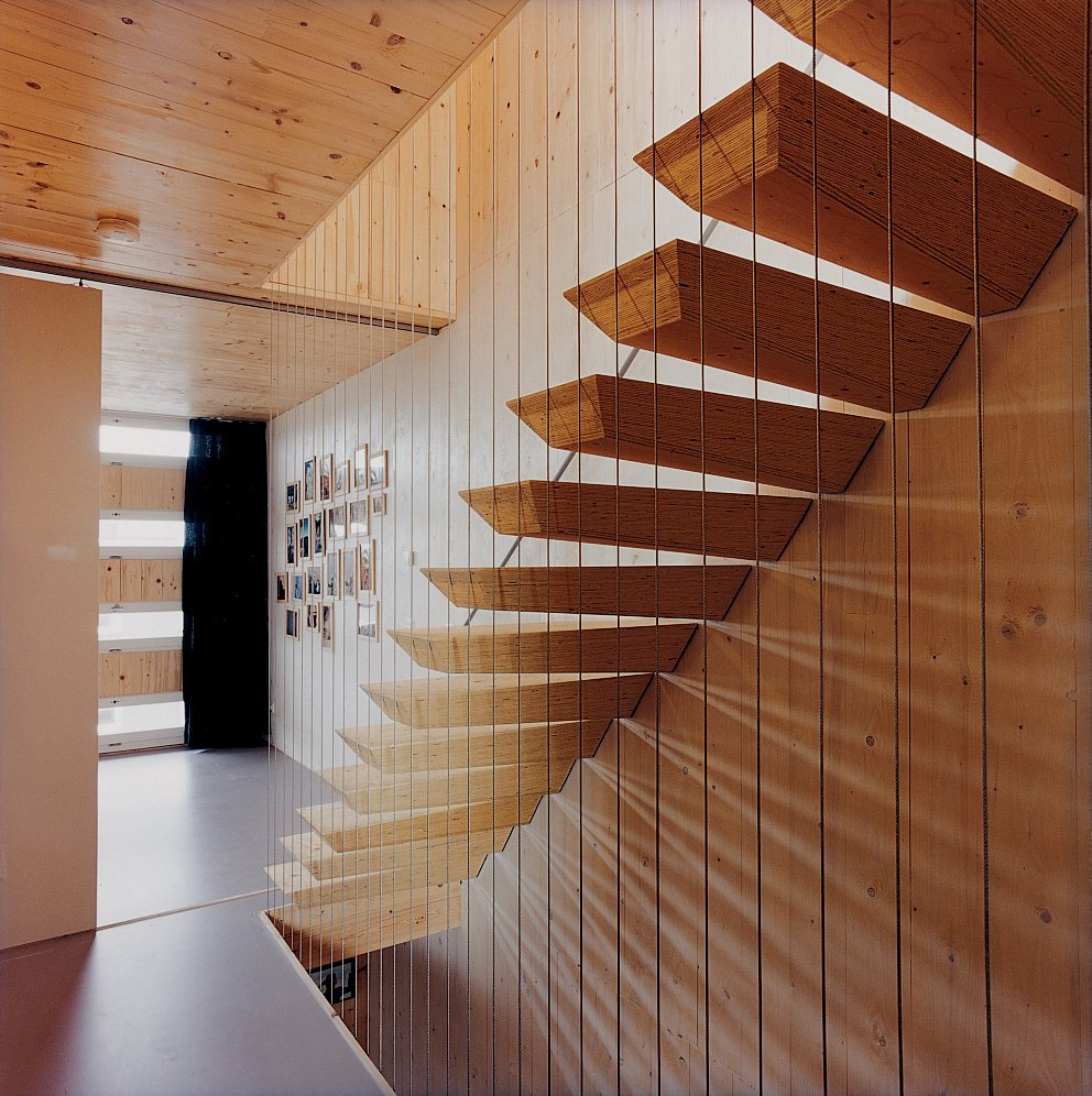 """Pieter Weijnen's brand of maritime modernism brings a touch of magic to Amsterdam's Steigereiland, where the architect built his family's home. The """"floating"""" staircase is actually supported by steel rods hidden within each step. Photo by: Hertha Hurnaus  190+ Best Modern Staircase Ideas by Dwell from Six Stairs to Savor"""
