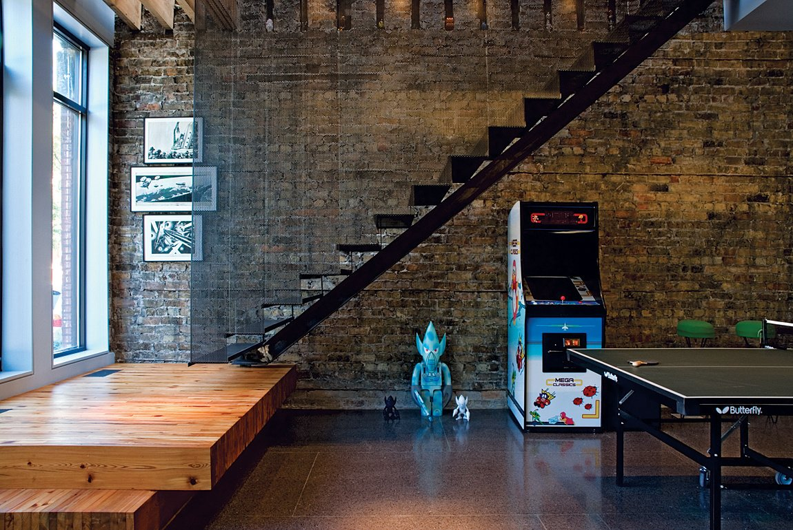 When it comes to material originality, this former tavern in Chicago's trendy Bucktown neighborhood pulls out all the stops. Gut-renovated by local firm Wilkinson Blender Architecture, the house is also comprehensively green. Photo by: Doug Fogelson/DRFP  190+ Best Modern Staircase Ideas by Dwell from Six Stairs to Savor