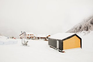 "This Prefab Ski School in the Alps Took 10 Days to Assemble - Photo 7 of 7 - The school building sits above the snow, on light piles instead of a permanent concrete foundation. This makes the building easily removable and, according to Girodo, ""avoids risks and complications during on-site construction."" The environmental impact of the facility's 10-day dry-assembly was minimal compared to traditional construction methods."