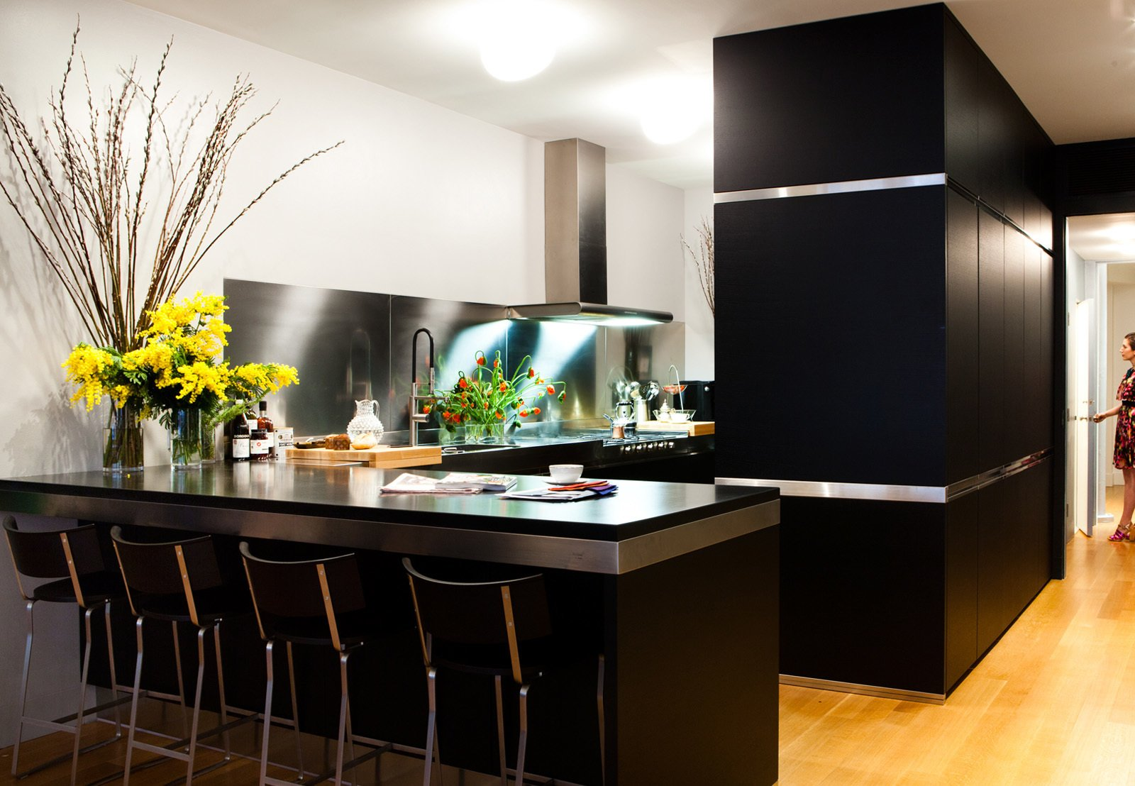 Arclinea's black cabinets with stainless-steel trim outfit the Manhattan kitchen of Dana Dramov.  Photo 11 of 11 in 10 Stunning Ways to Use Black in Your Kitchen from A Modern Kitchen Renovation in New York
