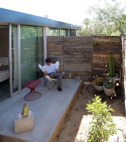 "Sheltered from the harsh Arizona sun, a north patio serves several important functions. It extends the apartment's footprint, encourages airflow, and provides a private corner for residents to relax away from the city buzz. ""Physical connection to the outdoors is paramount in a small space. It's physically and mentally healthier,"" Hall says."